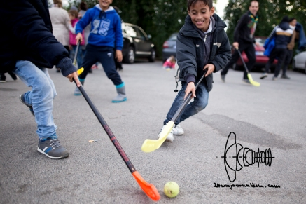 A Syrian refugee boy playing hockey.