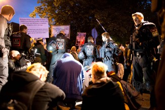 Civil unrest: Munich citizens sit down to show their mischief about racists marching through the city center.
