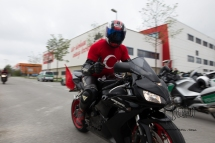 Biker in Turkish jersey driving by.