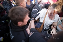 Protestors enter Bundesrat tent and get pushed out by police.