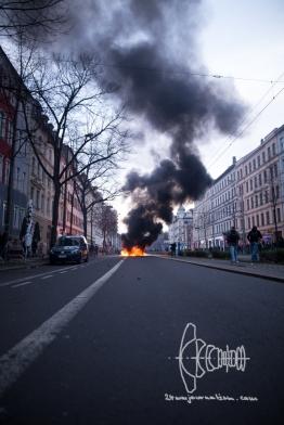 Smoke covers Leipzig Südstadt as barricades are burning.