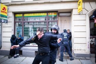 An activist gets beaten with a pepper spray can.