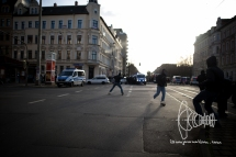 Left activists throw stones at approaching riot police blocking the road to the nazi route.