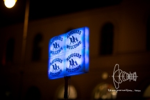 Glowing refugees welcome signs
