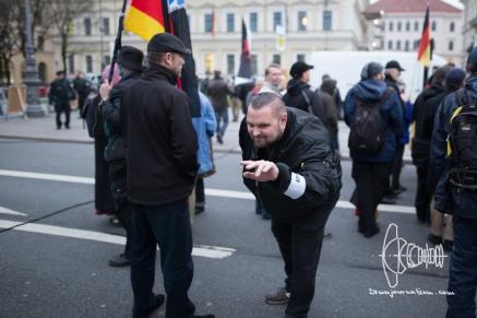 Stefan S. - PEGIDA marshal -poses for cameras.