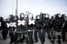 Protestors throw crayon bags on police forces