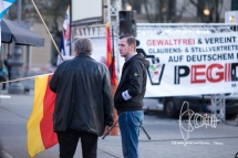 NPD activist and neo-nazi and used-to-be antifa Lukas Bals serving as marshal hold talk.