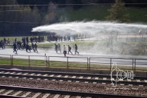 Water cannon against fleeing activists.