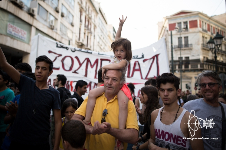 Refugee and supporters demonstrate through Athens