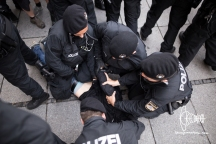 One counter-protestor is arrested. His hands off showing no ressistance.