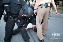 Activist gets pressed onto floor