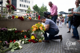 The day after the shooting at Munich OEZ shopping mall people deposite flowers to commemorate the ten killed people and the wounded. A gunmanopened fire in a McDonalds restaurant, then went into the shopping mal to afterwards kill himself just some hundred meters off the shooting site. No link to a terrorist group can be confirmed - police speaks of a rampage.