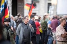 Heinz Meyer walks around PEGIDA gathering