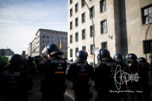 Demonstration is surrounded by police in front of the ministry of finances.