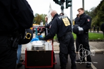 Police controlling pot with soup.