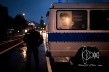 Policeman standing in the heavy rain.