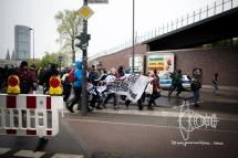 Activists running to errupt a roadblock.