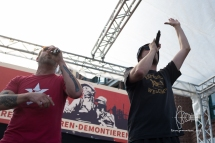 Captain Gips and Johnny Mauser perform on stage at rally on Fischmarkt