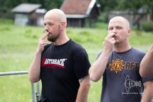 """Arriving participants signalizing a """"Hitler mustache"""""""